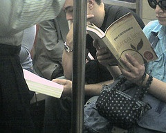 Reading on the subway. Everybody's doing it.