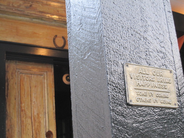 Horseshoe and plaque on Black Swan bar